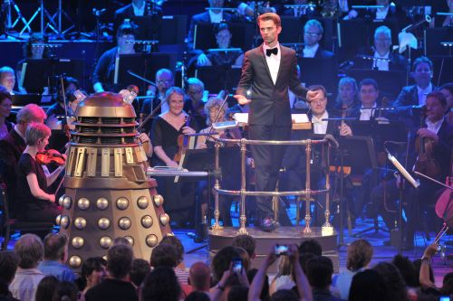 Photo of conductor Ben Foster and Dalek Doctor Who Prom 2013 Copyright: BBC/Chris Christodoulou